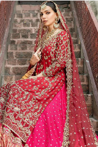 It's ALL in the details, This breathtaking wedding dress offers comfort without compromising on style. This outfit laden with ornamental embellishments and embroidery creates such a fairytale touch to your big day. Paired with a pink sharara creates an unusual charisma wholeheartedly. Embroidery is done in the shade of golden and tiny floral motifs scattered all over the shirt. Sharara is emphasized with sequins spray and zardozi details at the bottom. Complete the look with a red dupatta having scalloped borders and scattered tiny floral motifs all over the ground.