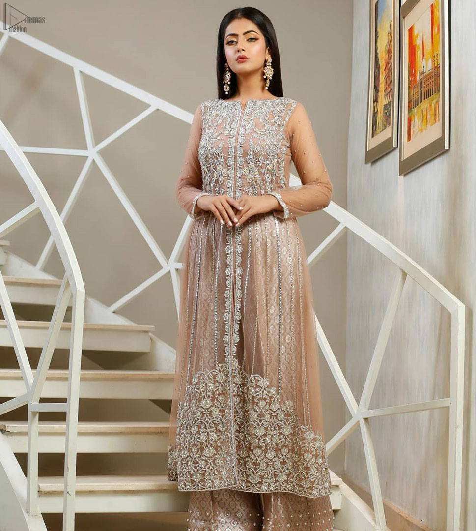 With pure fabric heavily embroidered with zardozi and the perfect blend of traditional flamboyance and modern elegance in design, you need to look no further for the perfect look for any formal occasion. The shirt is delicately crafted with silver zardozi work. The bodice is heavily laden with silver embellishment. Pair it up with tea rose palazzo pants scattered pearls on the bottom edge. The outfit is coordinated with net dupatta having kiran on all four sides.