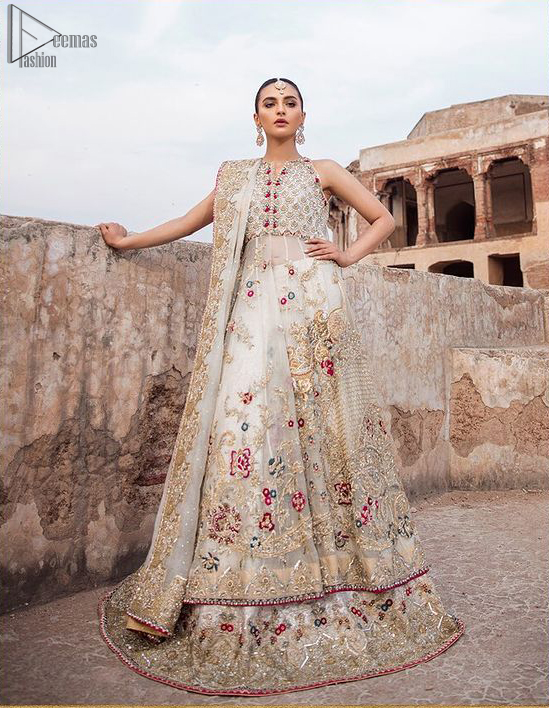 The new season is all about making a statement. It is an unforgettable look that will effortlessly take you from day to night this festive season. The bodice is fully embellished and the rest of the pishwas is ornamented with floral jaal with multiple color embroidery and thread work. The lehenga is more intensified with an embellished border with zardozi work on ivory canvas which instantly appeals to everyone's attention. Dupatta is adorned with a delicate arrangement of hand-embellished geometric patterns with kora, dabka,sequins, pearls, crystal, and Swarovski all around the edges.