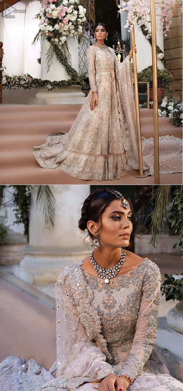 Beautiful Pakistani wedding dress in light peach front open pishwas with back train lehenga and emrboidered dupatta. This outfit brings drama and playfulness to traditional front open pishwas and lehenga with a modern approach. The mix of colours embroidery much of a choice for the festive season. The neckline is artistically decorated with kora, dabka, tilla, sequins and thread work. The rest of the outfit is adorned with floral bootis and finished with a scalloped hemline. Complete the look with an artfully coordinated lehenga which is ornamented with a bold and captivating back trail design with a traditional intricate embroidered. The classically balanced borders on the pure organza dupatta add exquisiteness to the look.
