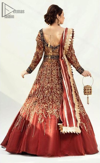 An exquisite full-sleeved gown followed by a marvellous churidar Pajama. This Maroon gown is made to perfection with splendid golden embroidery, beneath its beautiful sweetheart neckline.