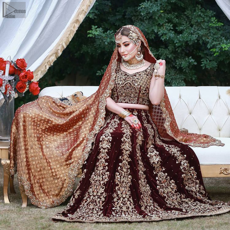 While an outstanding Maroon Velvet lehenga finalizes the overall dress, intensifying the sparkling copper embroidery over it.