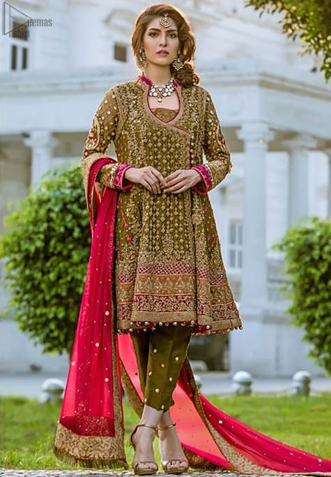 Olive green beautiful appearance enhanced with organza fabric which is in full bloom is completely embellished. Multicolour embroidery with many enchanting colours combination. Describing the exquisiteness of the Angrakha frock that is semi-formal with a round V neckline shape. The full sleeves are fully engraved with many stitching works such as Sequins and pearls along Tilla too. Cigarette pants in olive colour with round golden sequins work are one to wear with fixed waist belt alongside zip closure. The Pink Organza Dupatta with fully embellished four borders is a delight along with the costume. Mehndi Wear - Olive Green Angrakha Frock - Cigarette Pants