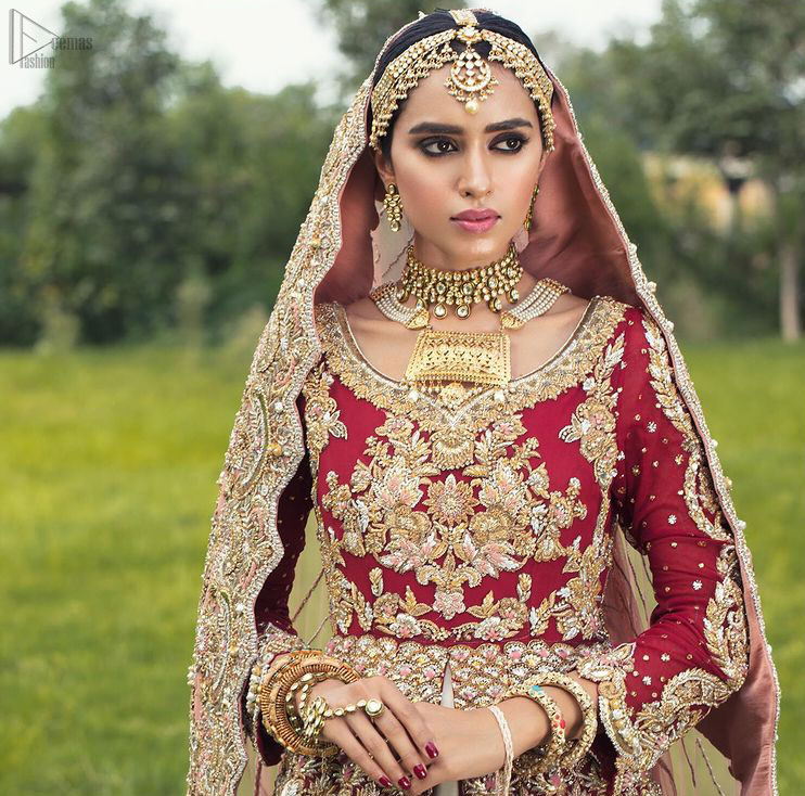 Best Nikah Dress - Red Front Open Gown Inner Ivory Lehenga Maxi. Glorify yourself by suiting up with the exceptional dress ranges from the house of DeemasFashion out of which one is here to make you graceful enough to make all jaws drop down. Red Organza with sweetheart necklined fully engraved, chantilly appliqued and giving a kind of look that you will surely love to have. Along with the elegant ivory coloured floral motifs having maxi lehenga in your drop-down menu of this gorgeous outfit. The fully embossed tea rose organza dupatta is giving major traditional vibes with scalloped borders that will surely suit your face beauty.