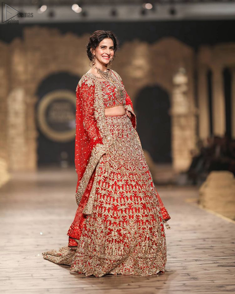 Pakistani Wedding Wear having Red Short Blouse Lehenga. Introducing a red blouse and lehenga to our wide range of charming bridal dresses.
