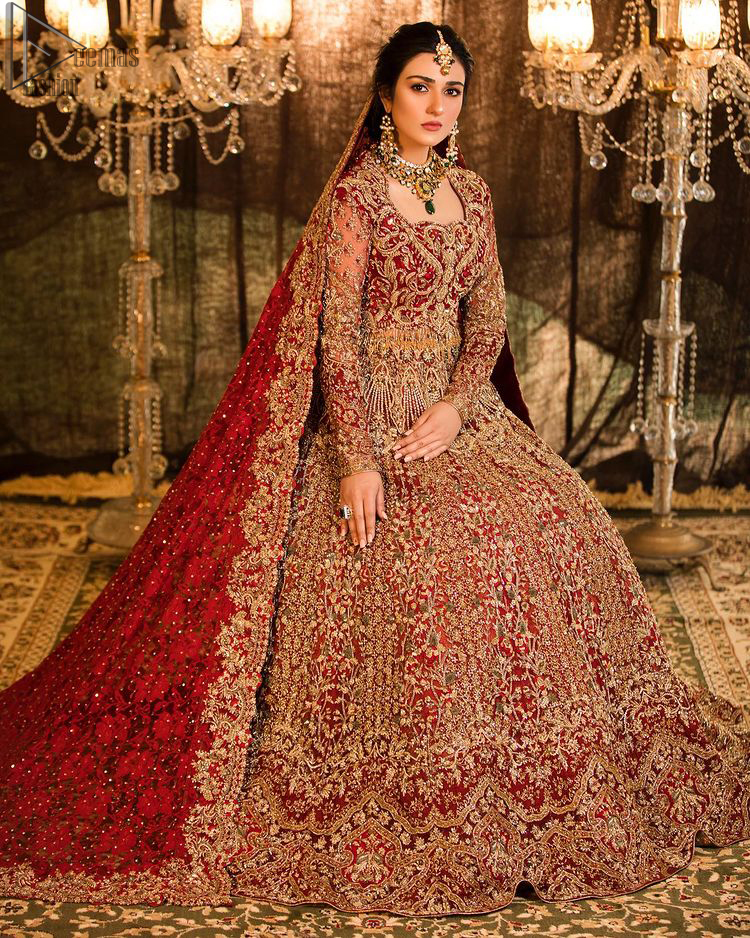 A truly exquisite ensemble that is sure to make heads turn on your big day. With a lot of attention to detail, the intricate sequencing using glass beading and threads makes the blouse look like nothing but a dream. Coordinated with a floor kissing asymmetrical lehenga adds to its charm. Intricate details, Refined craftsmanship is at its best with hand embellished zardozi work all over. Complete the look with a fully embellished dupatta adds the right amount of drama to this bridal outfit finished with scalloped borders and scattered sequins all over the ground.