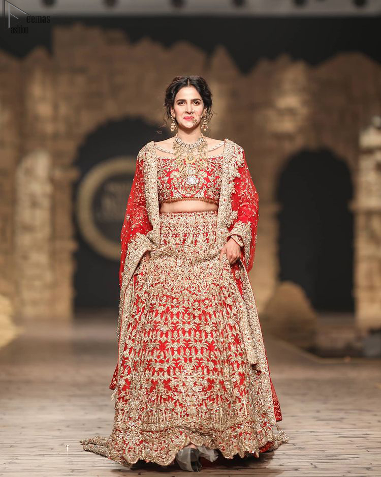Pakistani Wedding Wear having Red Short Blouse Lehenga. The dress is designed in full sleeves to add more to its grace.