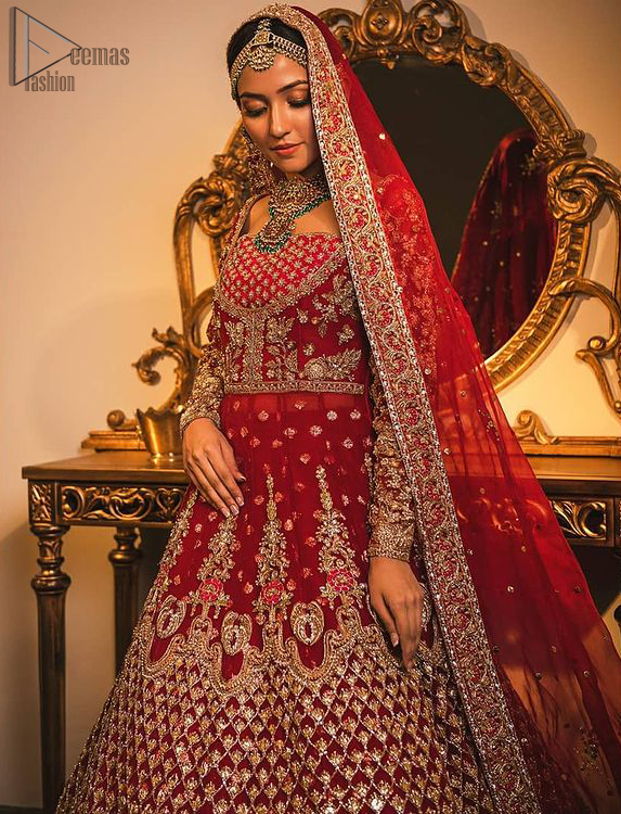 Make your moment memorable being a queen in red lehenga pishwas intensified with voguish sleeves and geometric patterns. This dreamy pishwas is adorned with an embellished bodice and finished with embroidered scallop border all around which gave a perfect ending to this flare. Lehenga is artistically adorned with tiny motifs all over the ground. Finish the look with a red accentuated lehenga having four-sided embellished borders and sequins spray all over the ground. Making it true that you can turn all the heads around with your gorgeous ability to wear the outfit in a way that is spectacular.