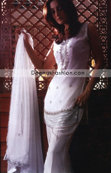Modern yet traditional: Feel glamorous in this shirt with fascinating embellishment with silver kora dabka, pearl and sequins. Neckline is fully embellished and also sprinkled small floral motifs all over the shirt. Rich embellishment on hemline instantly draws attention. It is coordinated with straight trousers and white chiffon dupatta having four sided embellished borders and sequins spray all over.