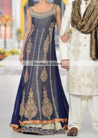 Frock has been adorned with embroidered neckline and motifs on both sides. Center panel has been embellished with large motifs and small borders. Embroidered lace implemented at the bottom of lehenga. This dress comes with matching dupatta.