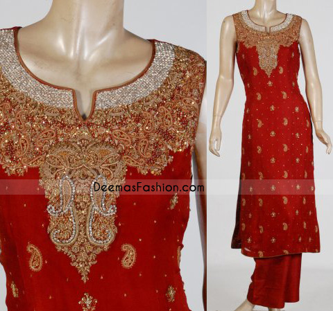Red Katan silk shirt having floral embroidery on neckline. sequins and paisleys motifs all over. Piping edges finished.