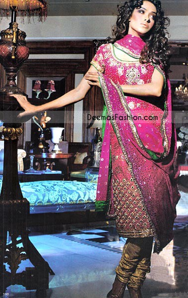 Shocking Pink Pure Banarsi long shirt embellished with embroidered neckline, sleeve and heavy border on bottom and golden banarsi fabric is used on hemline. Embroidery includes using sequins pearls shaped beads, kora, tilla and crystals. Finished with green piping on neck, sleeves and hemline. This outfit is coordinated with churidar pajama and pink chiffon dupatta with sequins spray all over and green piping all around the borders.
